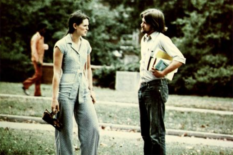 Male and female students dressed on 70's styles