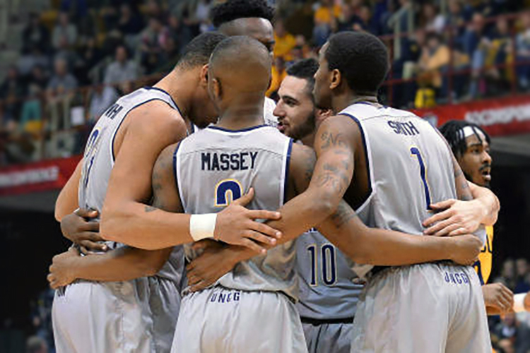 UNCG basketball team huddle